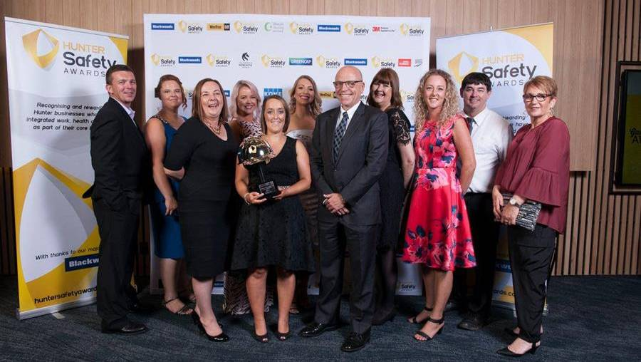 SAFETY FIRST: Anglican Care staff with their award. Picture: Supplied.