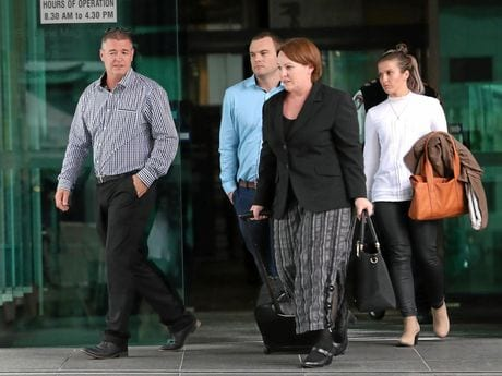 Michael Ackerman (left), father of James Ackerman, and Saraa Ackerman (right, white top) leaves the pre-inquest conference into his death . Courts. Pic Darren England.